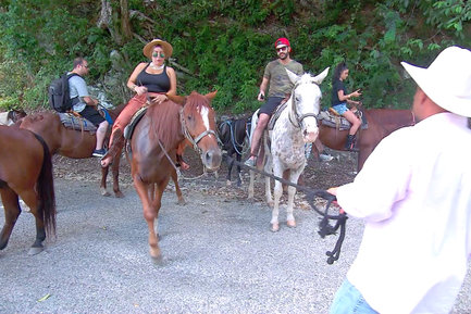 The group rode horses to the Mayan Ruins.